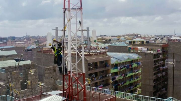 A wireless communication terminal on the rooftop of a large building in Kenya.