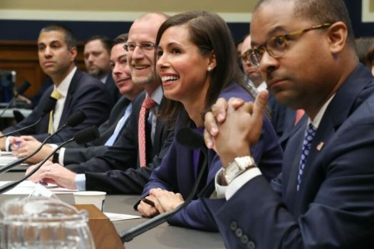 All five FCC commissioners sitting at a table in front of microphones at a congressional hearing.