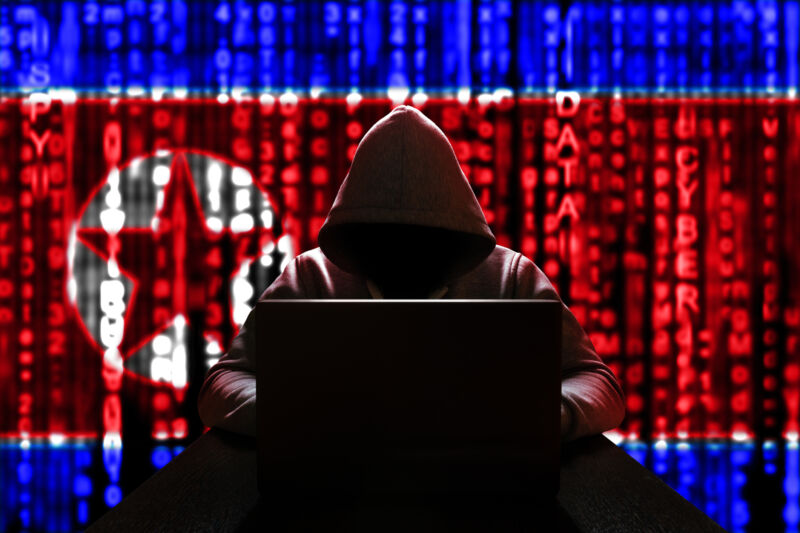 Cyber threat from North Korea. North Korean hacker at the computer, on a background of binary code, the colors of the flag of the DPRK. DDoS attack