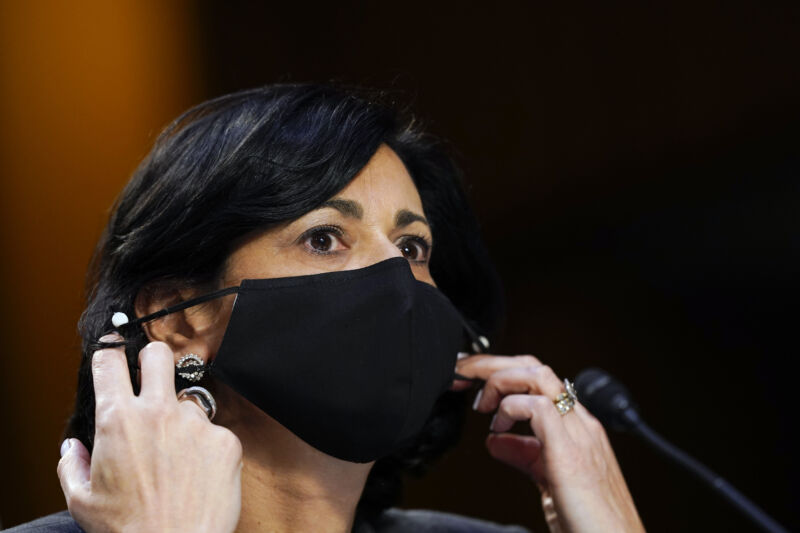 Rochelle Walensky, director of the US Centers for Disease Control and Prevention (CDC), adjusts her protective mask during a Senate Health, Education, Labor, and Pensions Committee hearing in Washington, DC. Susan Walsh/AP/Bloomberg via Getty Images