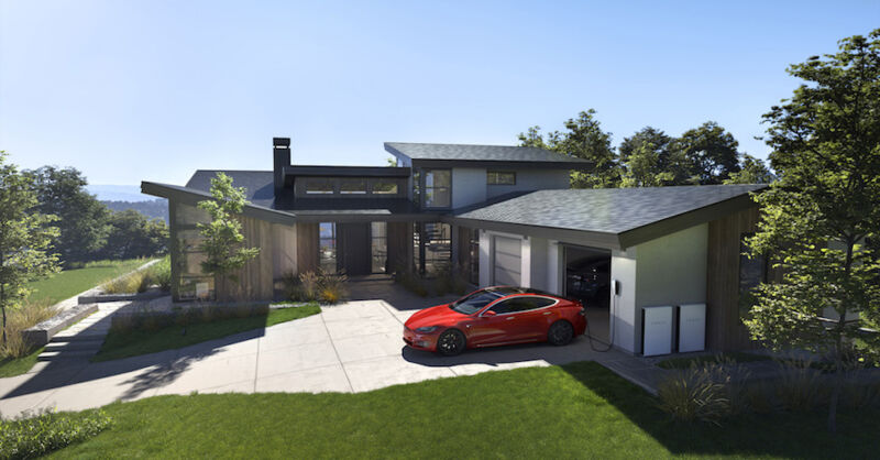An upscale suburban house has a Tesla in the driveway and solar panels on the roof.