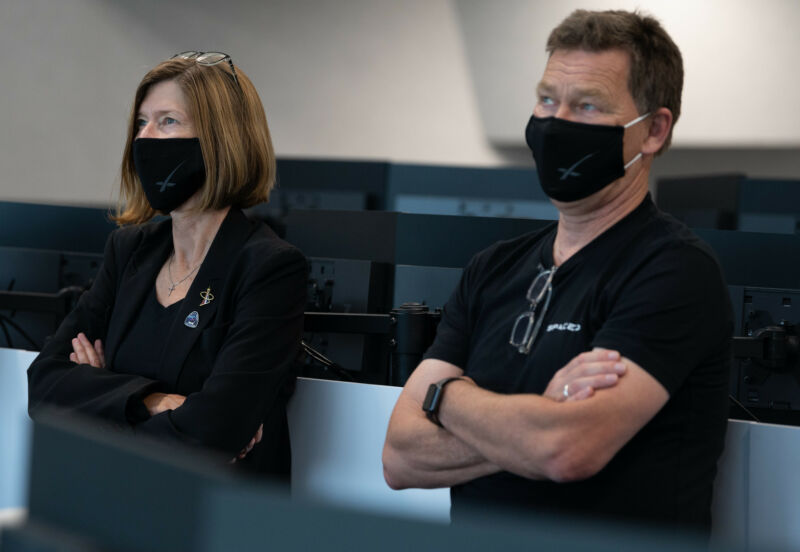NASA's Kathy Lueders, left, and SpaceX's Hans Koenigsmann track the Demo-2 crew mission in 2020. SpaceX is helping to enable NASA to think less about transportation and more about exploration.