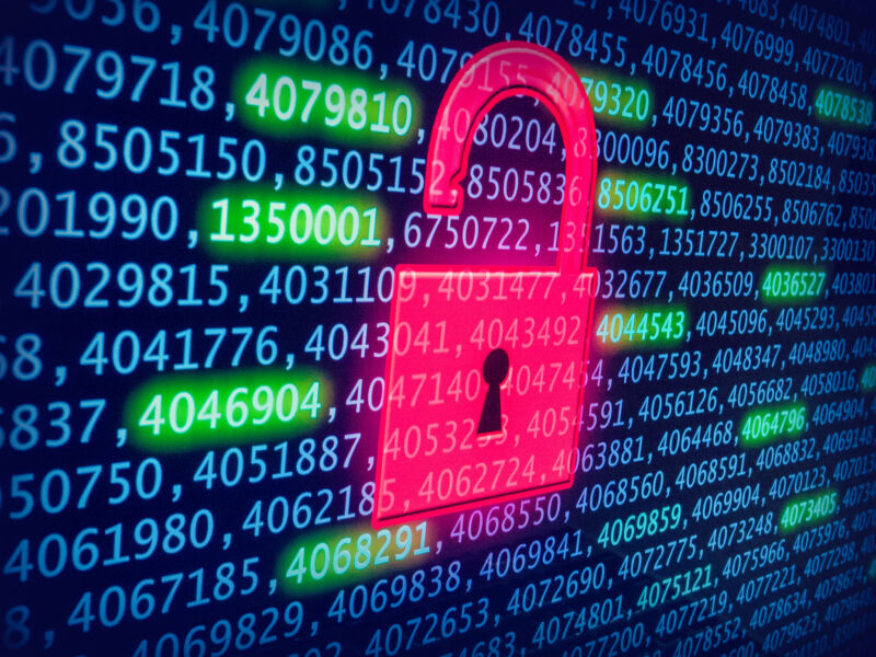 A computer screen filled with numbers is interrupted by a rudimentary image of a padlock.
