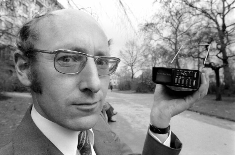 Sir Clive Sinclair holding the world's smallest television screen when it was created by Sinclair Radionics in 1977.