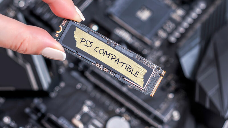 Extreme close-up photograph of fingers holding computer component labeled PS5 compatible.