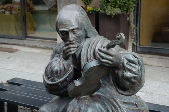 Close-up of the sculpture of Antonio Stradivari (1644–1737) in Corso Garibaldi, Cremona, Italy.