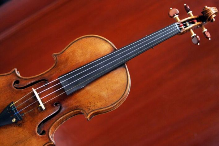 Violin against a red background.