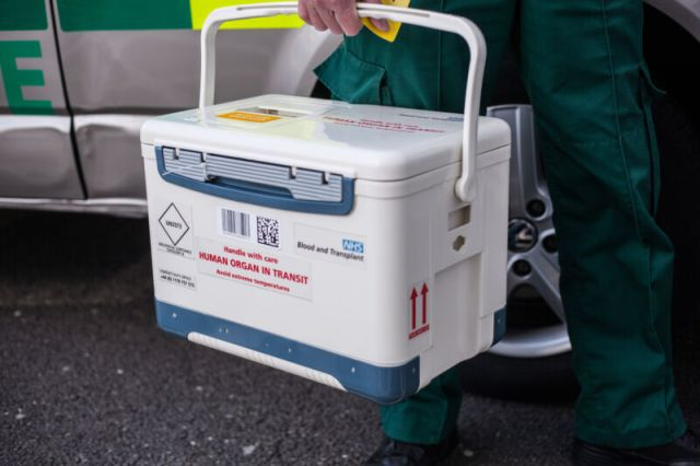 Close up of a paramedic holding an organ transplant box, Birmingham, on 18 August 2017.  A SELFLESS mum risked her life by bravely undergoing a double organ donation for her four-year-old son. Sarah Lamont, from Ballymena, Northern Ireland has donated one of her kidneys to her youngest child, Joe, mere months after surgeons removed a section of her liver to save the boy?s life. Joe?s diseased kidneys were removed when he was just a few days old, and he has been on dialysis ever since. But Sarah?s second incredible gift to her son means Joe might, for the first time, live a life free of almost daily hospital visits and procedures, and be able to go to school.  PHOTOGRAPH BY Marcus Hessenberg / Barcroft Images (Photo credit should read Marcus Hessenberg / Barcroft Media via Getty Images / Barcroft Media via Getty Images)