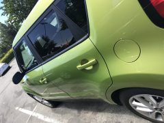 Cute Green Rental Car made me smile by Denise M. Colby