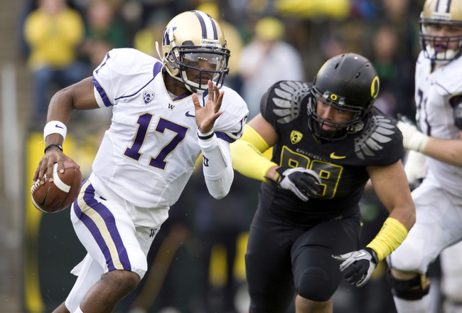 EUGENE, OR - NOVEMBER 6: Quarterback Keith Price #17 of the Washington Huskies is chased by defensive tackle Zac Clark #99 of the Oregon Ducks in the third quarter of the game at Autzen Stadium on November 6, 2010 in Eugene, Oregon. The Ducks won the game 53-16. (Photo by Steve Dykes/Getty Images)