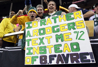 ATLANTA, GA - JANUARY 15:  Fans of the Green Bay Packers hold up a sign which reads 'I'd Rather Aaron Rodgers text me instead of Brett Favre after the Packers defeated the Atlanta Falcons 48-21 during their 2011 NFC divisional playoff game at Georgia Dome on January 15, 2011 in Atlanta, Georgia.  (Photo by Streeter Lecka/Getty Images)