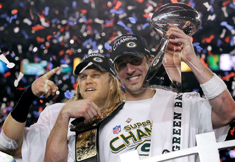 ARLINGTON, TX - FEBRUARY 06:  Aaron Rodgers #12 and Clay Matthews #52 of the Green Bay Packers of the Green Bay Packers holds the Lombardi Trophy after defeating the Pittsburgh Steelers 31-25 during Super Bowl XLV at Cowboys Stadium on February 6, 2011 in Arlington, Texas.  (Photo by Ronald Martinez/Getty Images)
