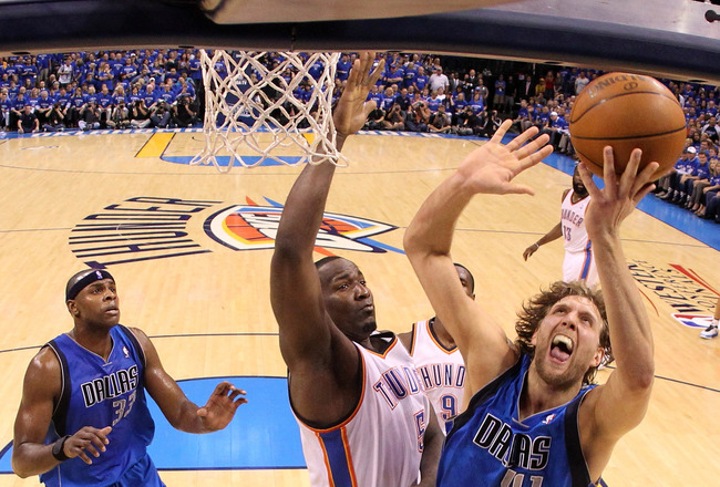 OKLAHOMA CITY, OK - MAY 23:  Dirk Nowitzki #41 of the Dallas Mavericks goes up for a shot against Kendrick Perkins #5 of the Oklahoma City Thunder in the first half in Game Four of the Western Conference Finals during the 2011 NBA Playoffs at Oklahoma City Arena on May 23, 2011 in Oklahoma City, Oklahoma. NOTE TO USER: User expressly acknowledges and agrees that, by downloading and or using this photograph, User is consenting to the terms and conditions of the Getty Images License Agreement.  (Photo by Ronald Martinez/Getty Images)