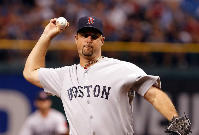 ST PETERSBURG, FL - JUNE 14: : Pitcher Tim Wakefield #49 of the Boston Red Sox pitches against the Tampa Bay Rays during the game at Tropicana Field on June 14, 2011 in St. Petersburg, Florida. (Photo by J. Meric/Getty Images)