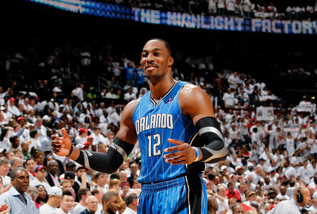 ATLANTA, GA - APRIL 22:  Dwight Howard #12 of the Orlando Magic against the Atlanta Hawks during Game Three of the Eastern Conference Quarterfinals in the 2011 NBA Playoffs at Philips Arena on April 22, 2011 in Atlanta, Georgia.  NOTE TO USER: User expressly acknowledges and agrees that, by downloading and or using this photograph, User is consenting to the terms and conditions of the Getty Images License Agreement.  (Photo by Kevin C. Cox/Getty Images)
