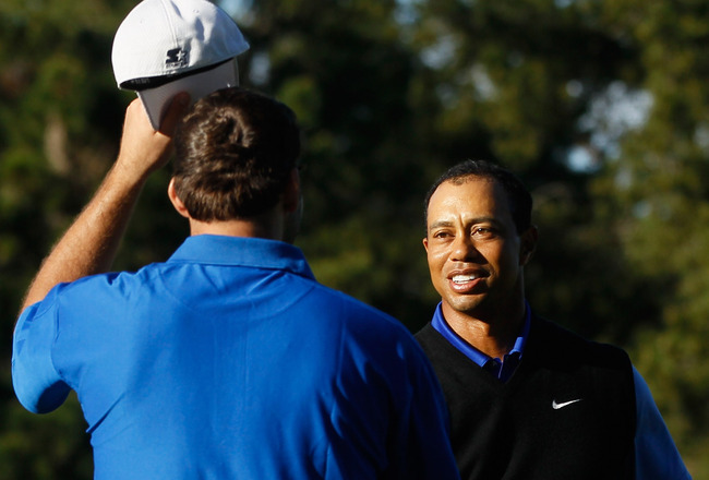 PEBBLE BEACH, CA - FEBRUARY 09:  American football player Tony Romo (L) and playing partner Tiger Woods shake hands following their round during the AT&T Pebble Beach National Pro-Am at the Spyglass Hill Golf on February 9, 2012 in Pebble Beach, California.  (Photo by Jeff Gross/Getty Images)