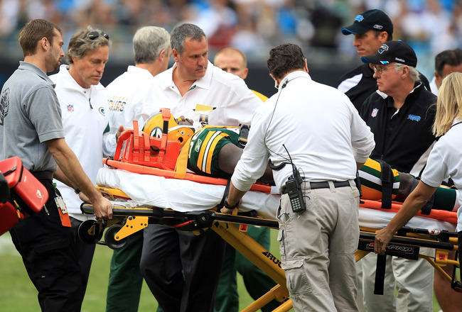CHARLOTTE, NC - SEPTEMBER 18:  Play is stoped as Nick Collins #36 of the Green Bay Packers is injured against the Carolina Panthers during their game at Bank of America Stadium on September 18, 2011 in Charlotte, North Carolina.  (Photo by Streeter Lecka/Getty Images)