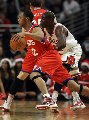 CHICAGO, IL - DECEMBER 21: Evan Turner #12 of the Philadelphia 76ers moves past Ronnie Brewer #11 of the Chicago Bulls at the United Center on December 21, 2010 in Chicago, Illinois. The Bulls defeated the 76ers 121-76. NOTE TO USER: User expressly acknow