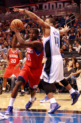 ORLANDO, FL - DECEMBER 18:  Jrue Holiday #11 of the Philadelphia 76ers drives against Jameer Nelson #14 of the Orlando Magic during the game at Amway Arena on December 18, 2010 in Orlando, Florida.  NOTE TO USER: User expressly acknowledges and agrees tha