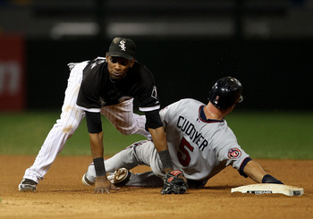 CHICAGO - SEPTEMBER 14: Alexei Ramirez #10 of the Chicago White Sox falls over Michael Cuddyer #5 of the Minnesota Twins after turning a double play at U.S. Cellular Field on September 14, 2010 in Chicago, Illinois. (Photo by Jonathan Daniel/Getty Images)