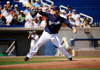 PHOENIX, AZ - MARCH 10:  Chris Narveson #38 pitcher of the Milwaukee Brewers throws a pitch against the Colorado Rockies during the spring training baseball game at Maryvale Baseball Park on March 10, 2011 in Phoenix, Arizona.  (Photo by Kevork Djansezian