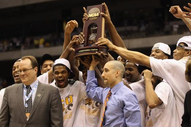 SAN ANTONIO, TX - MARCH 27:  Head coach Shaka Smart of the Virginia Commonwealth Rams holds up the trophy after defeating the Kansas Jayhawks during the southwest regional final of the 2011 NCAA men's basketball tournament at the Alamodome on March 27, 20