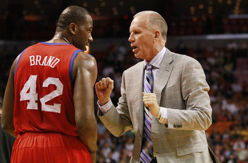 MIAMI, FL - MARCH 25:  Coach Doug Collins and Guard Elton Brand #42 of the Philadelphia Sixers chat against the Miami Heat at American Airlines Arena on March 25, 2011 in Miami, Florida. The Heat defeated the Sixers 111-99. NOTE TO USER: User expressly ac