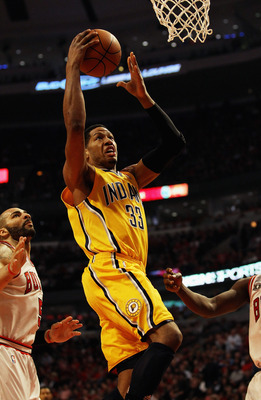 CHICAGO, IL - APRIL 26: Danny Granger #33 of the Indiana Pacers drives to the basket past Carlos Boozer #5 of the Chicago Bulls in Game Five of the Eastern Conference Quarterfinals in the 2011 NBA Playoffs at the United Center on April 26, 2011 in Chicago