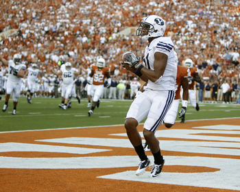 AUSTIN, TX - SEPTEMBER 10:  Wide receiver Ross Apo #11 of the BYU Cougars catches a second quarter touchdown pass by Jake Heaps against the Texas Longhorns on September 10, 2011 at Darrell K. Royal-Texas Memorial Stadium in Austin, Texas.  (Photo by Erich