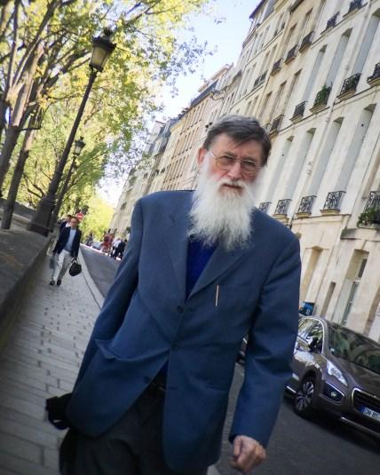 A Parisian man on the street in Paris, France.