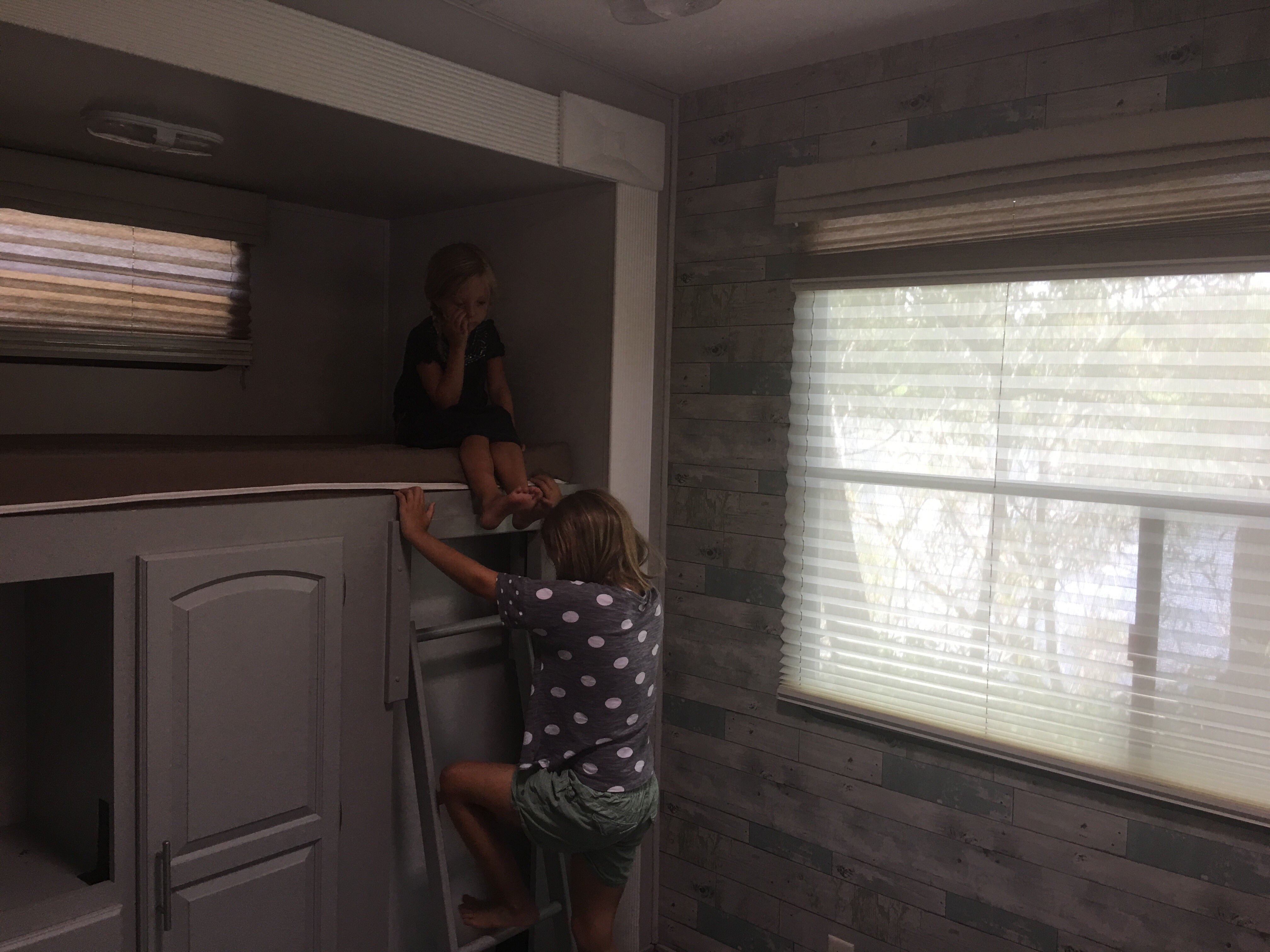 The girls checking out an RV bunk room