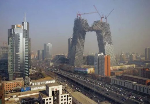 Beijing   national capital  China   Britannica com China Central Television  CCTV  Building  right centre background  under  construction in