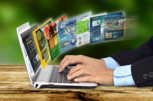 Businessman hand browsing internet websites on his laptop