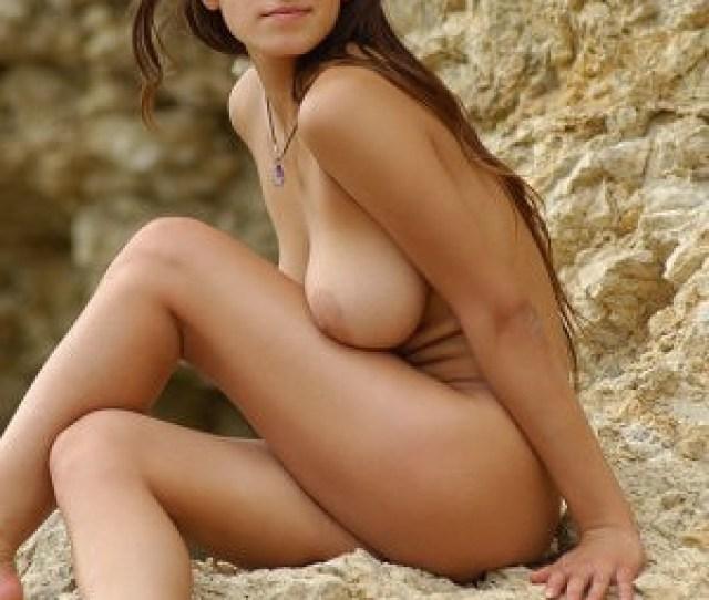 Sofia A Poses Nude On The Rocks