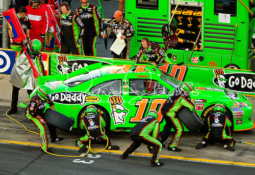 Photo: GoDaddy.com pit crew members work to get driver Danica Patrick back on the track during a pit stop.