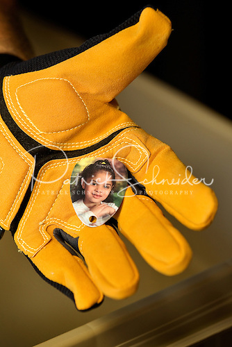 Photo of an employee volunteer's hand holding a photo salvaged during flood cleanup in Live Oaks, Florida.
