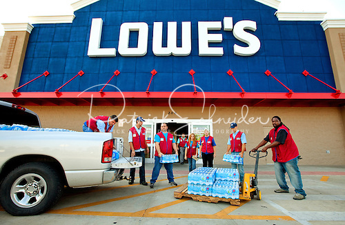 CSR photography of Lowe's employees loading bottled water to be donated to flood victims after Tropical Storm Debby hit Florida in 2012.