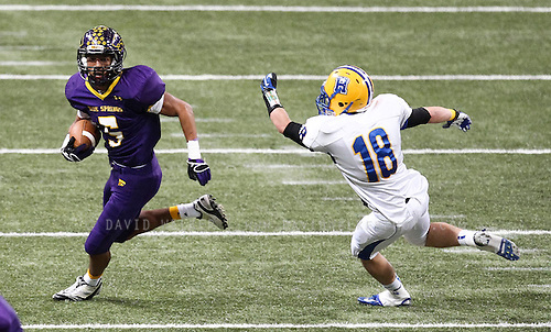 Jayme Allen (5) of the Blue Springs Wildcats runs past Adam Fazio (18) of the Francis Howell Vikings during the 2012 MSHSAA football class 6 state championship game at the Edward Jones Dome on November 24, 2012 in St. Louis, Missouri.