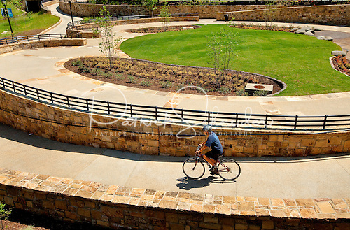 Photo: A biker weaves through the winding pathways of Midtown Park.