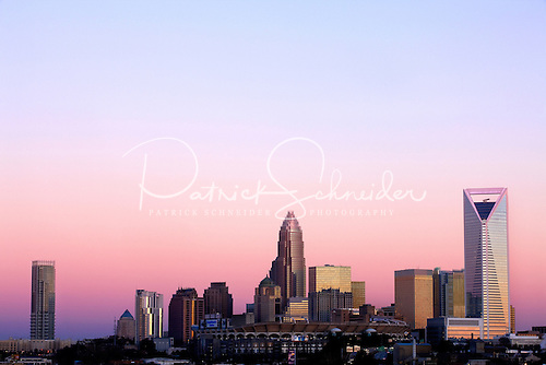 Photo of Charlotte skyline changing vibrancy as sun sets