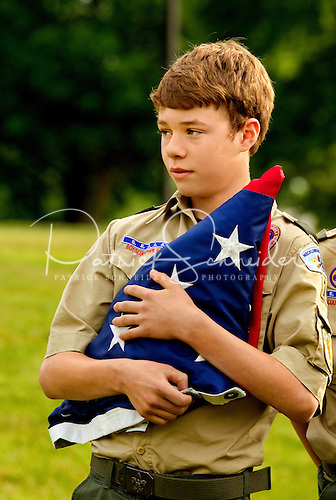 Photo: Boy Scouts holding an American flag at the start of a flag ceremony during a BSA event.