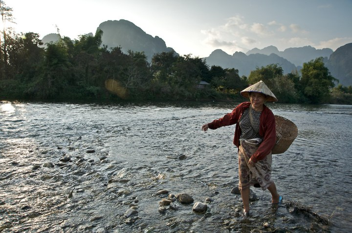 A woman crosses the Nam Song River - nomadruss