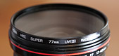photo of a 77 mm UV filter on a lens