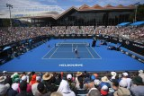 A high shot of an outdoor court as two players play a match at the Australian Open