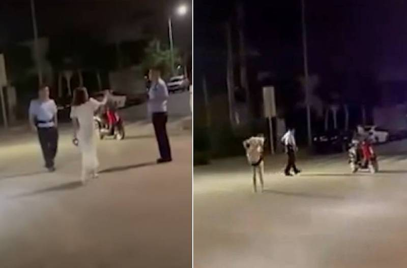 Australia-A drunken woman in a dress takes off her panties and acts as a weapon attack on the police!Was thrown down on the spot (video) | Australia Chinatown