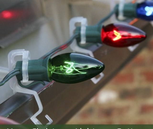 Use Clips To Hang Christmas Lights On Gutters