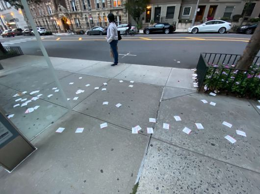 A photo of lotto tickets all over the ground on the UWS