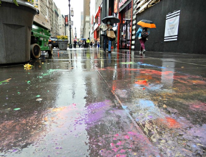 Colorful sidewalk splotches on a rainy day in midtown.