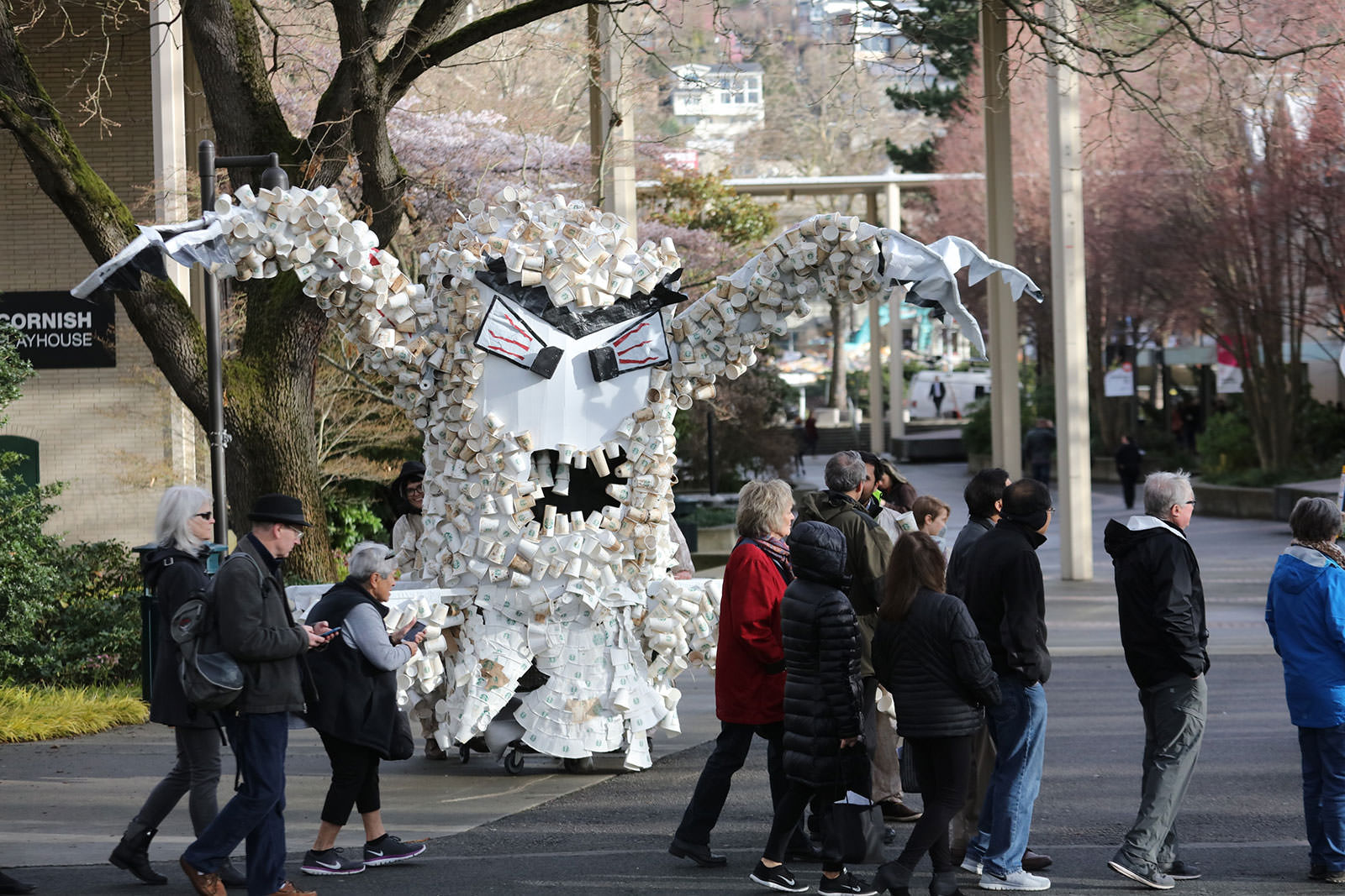 "Stand.Earth activists erected a ""cup monster"" to pressure Starbucks to address its waste. (Steve Ringman/The Seattle Times)"