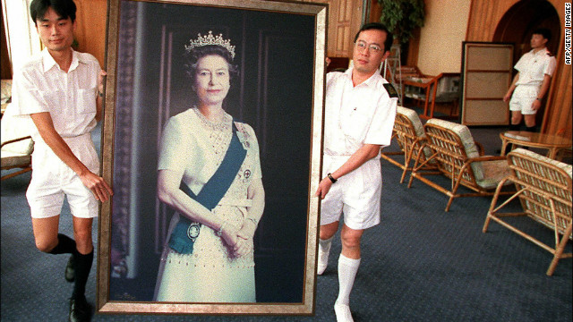Two Royal Navy sailors carry a portrait of Queen Elizabeth through the British Forces' Hong Kong headquarters as her pictures are taken down ahead of the handover of Hong Kong in 1997.